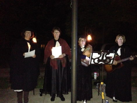 Singers performing historic songs during the 2013 cemetery walk.
